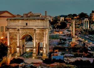 The Roman Forum by night with the Septimius Severus Triomphal Arch, the Foca Column and Castor and Pollux Temple in Rome in Italy