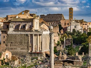 The Roman Forum with the Antoninus and Faustina Temple and the Colosseum in the background, in Rome in Italy