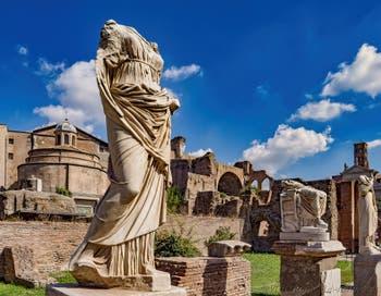 Vestal' Statue along the Vestals Atrium in the Roman Forum in Rome in Italy