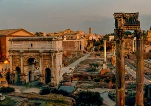 The Via Sacra by night in the centre of the Roman Forum in Rome in Italy