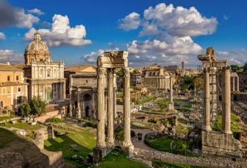 The Roman Forum, on the right, the Saturn Temple Columns, in Rome in Italy